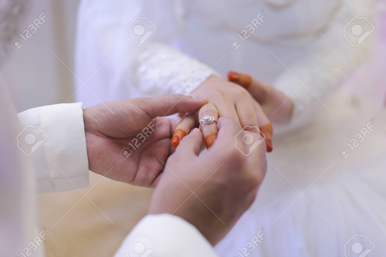 Groom Put Ring On Bride Hand Stock Photo, Picture And Royalty Free ...