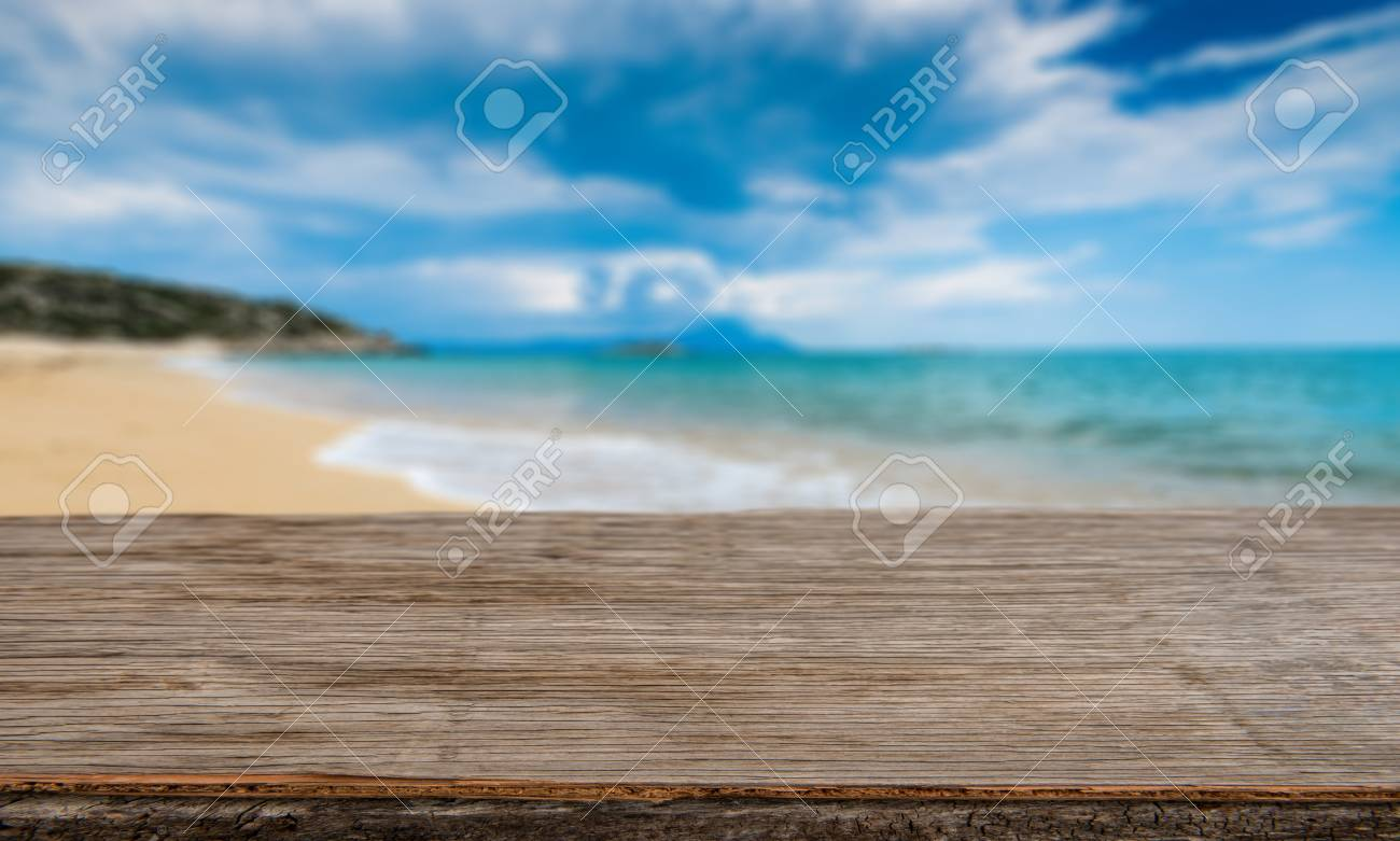 empty wooden table top and tropical beach scene background mockup