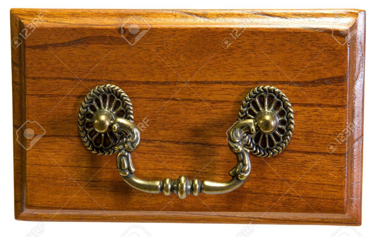 oak drawer front with antique brass drawer pull stock photo