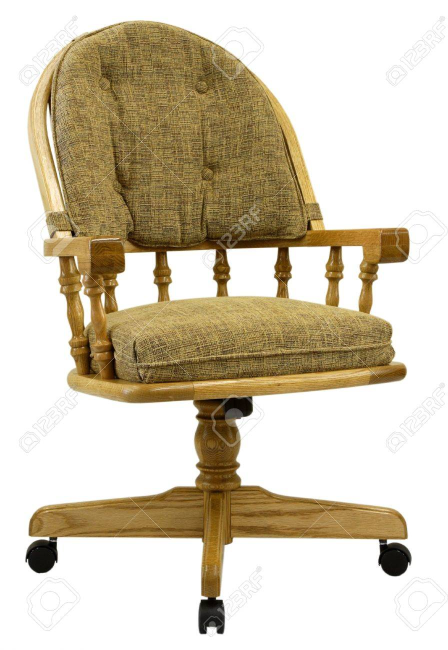 solid oak swivel caster dining chair stock photo