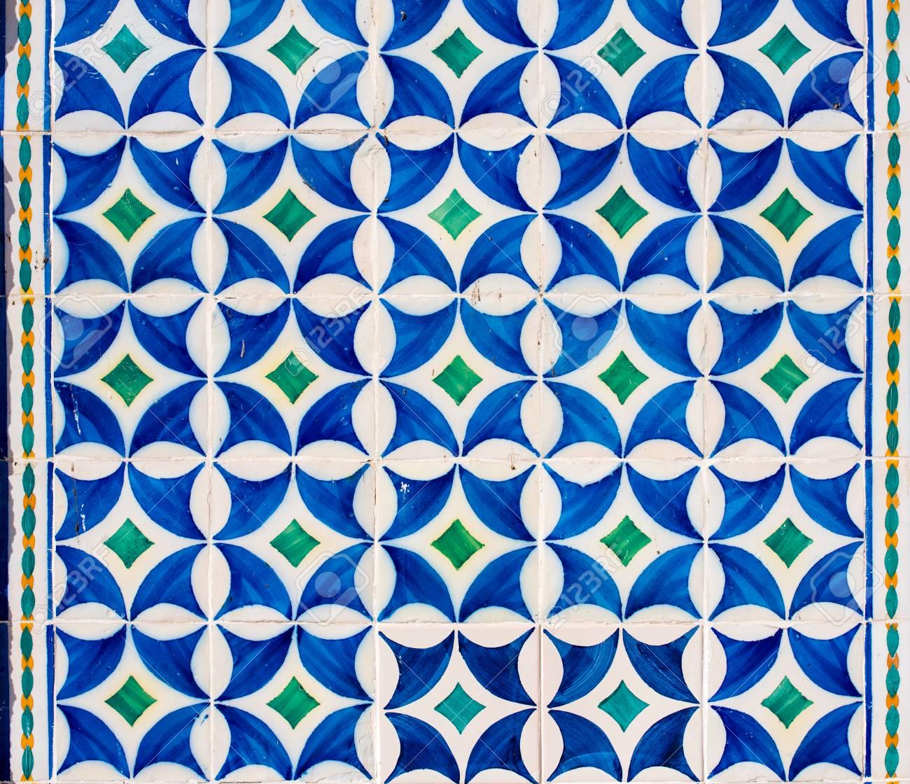 Typical Portuguese Ceramic Tiles Azulejos On A Facade Of A Building
