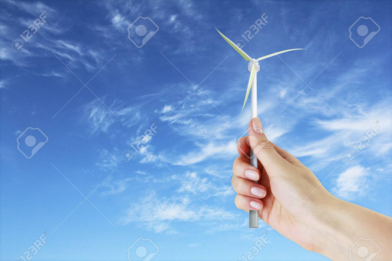 Windmill in the hand on a sky background Stock Photo - 17855745