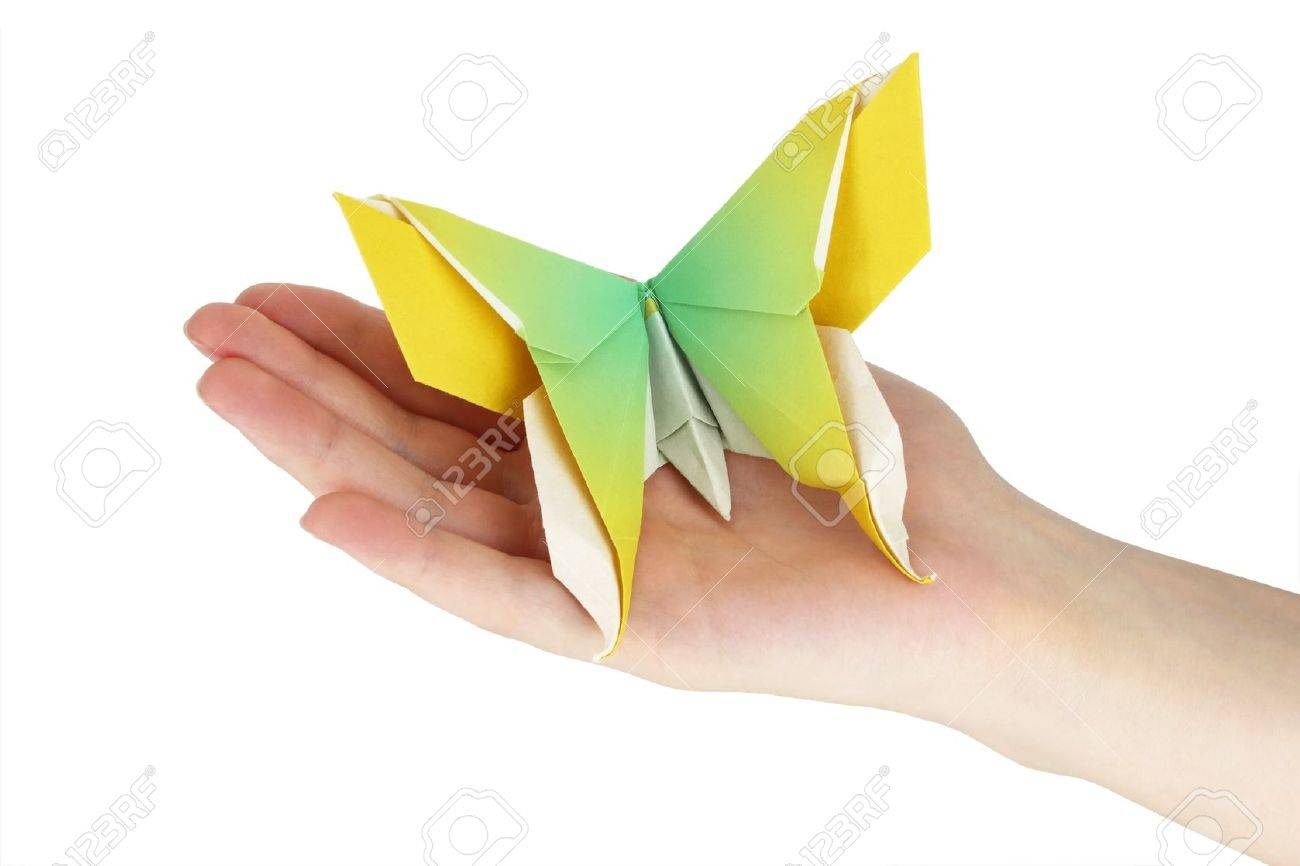 Origami butterfly in the human hand Stock Photo - 18660983