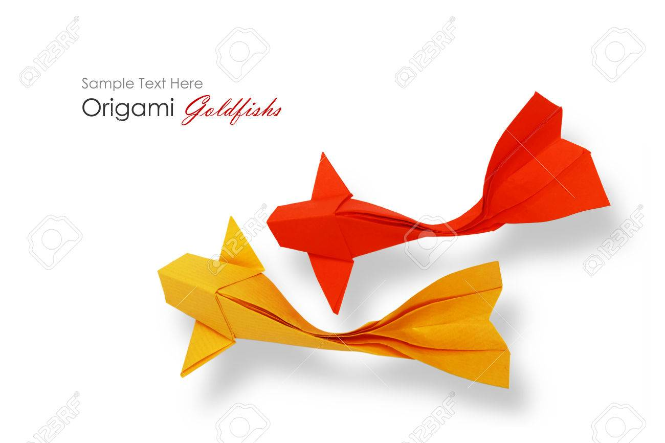 Origami Paper Red Goldfish On A Green White Background Stock Photo