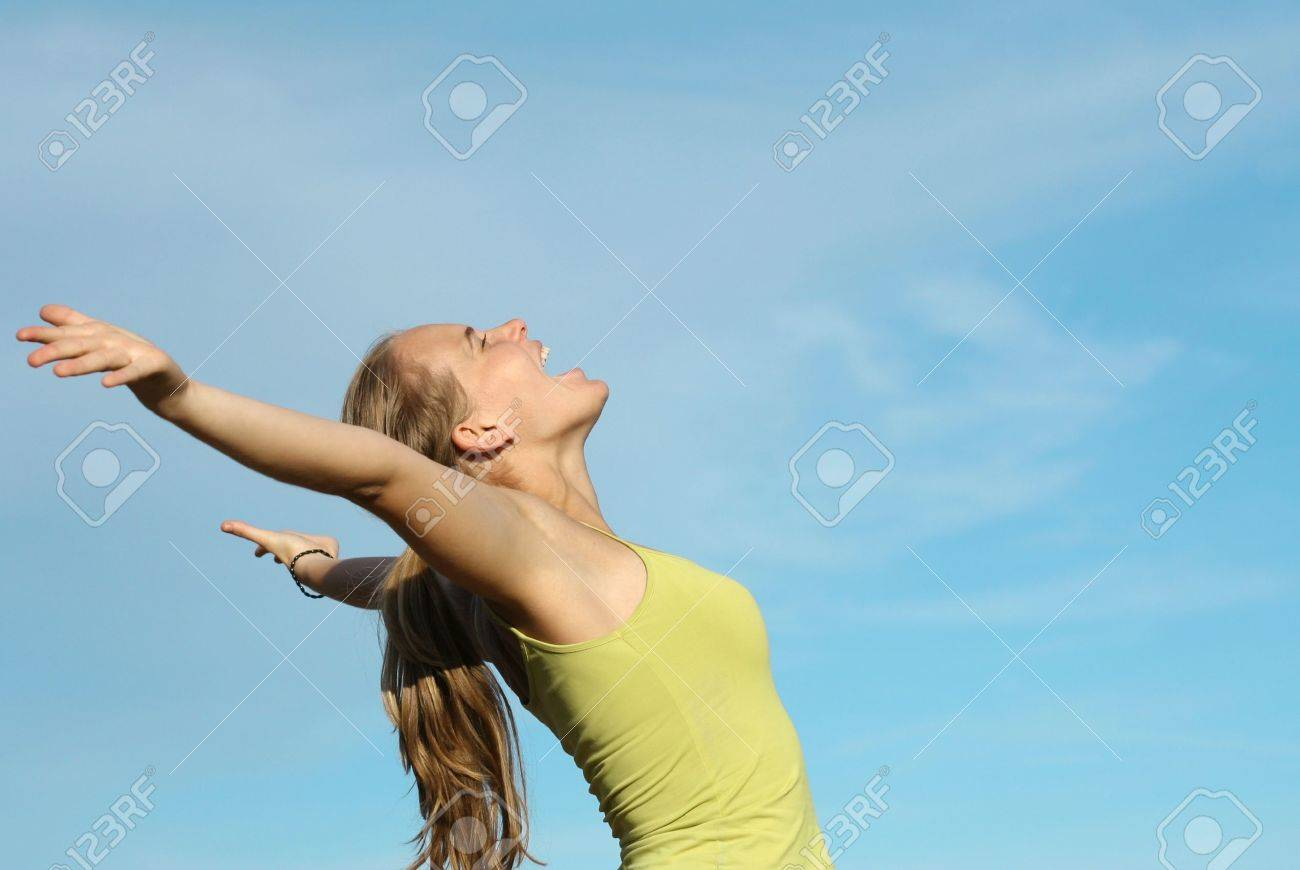 young woman arms raised Stock Photo - 2650361