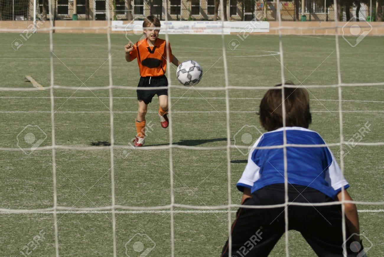 young boys playing football Stock Photo - 2697763