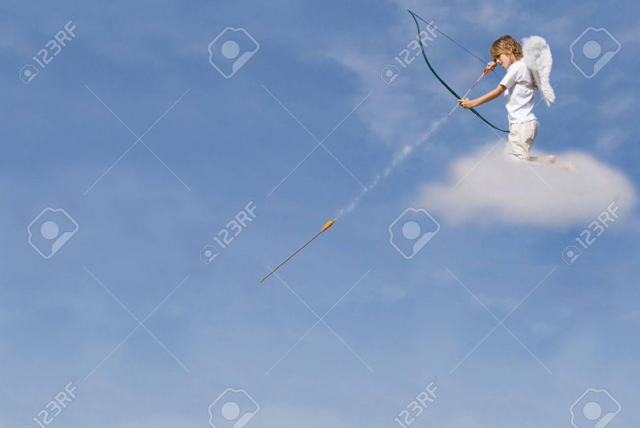 cupid kneeling in cloud Stock Photo - 3054426