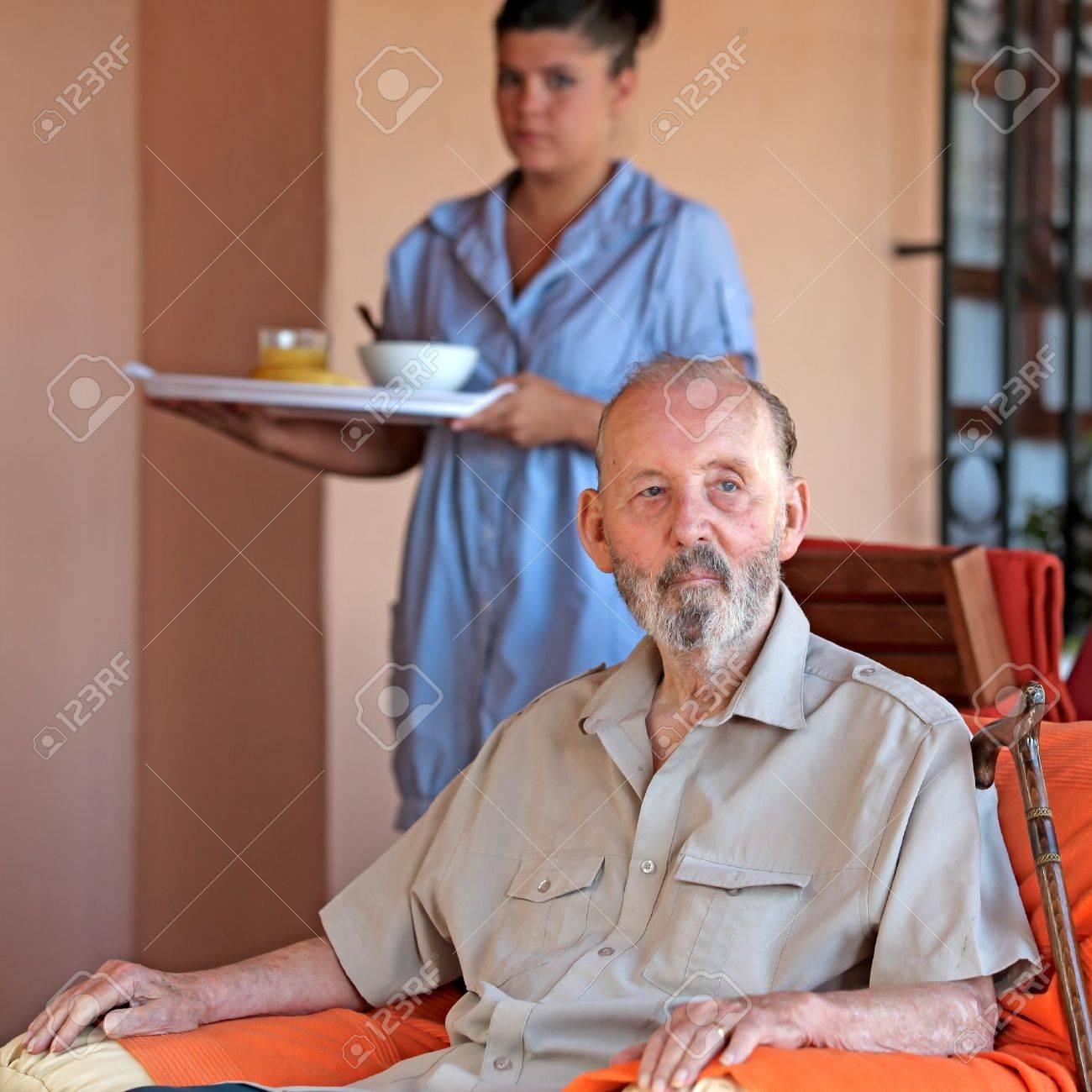 elderly senior man with carer Stock Photo - 8398676