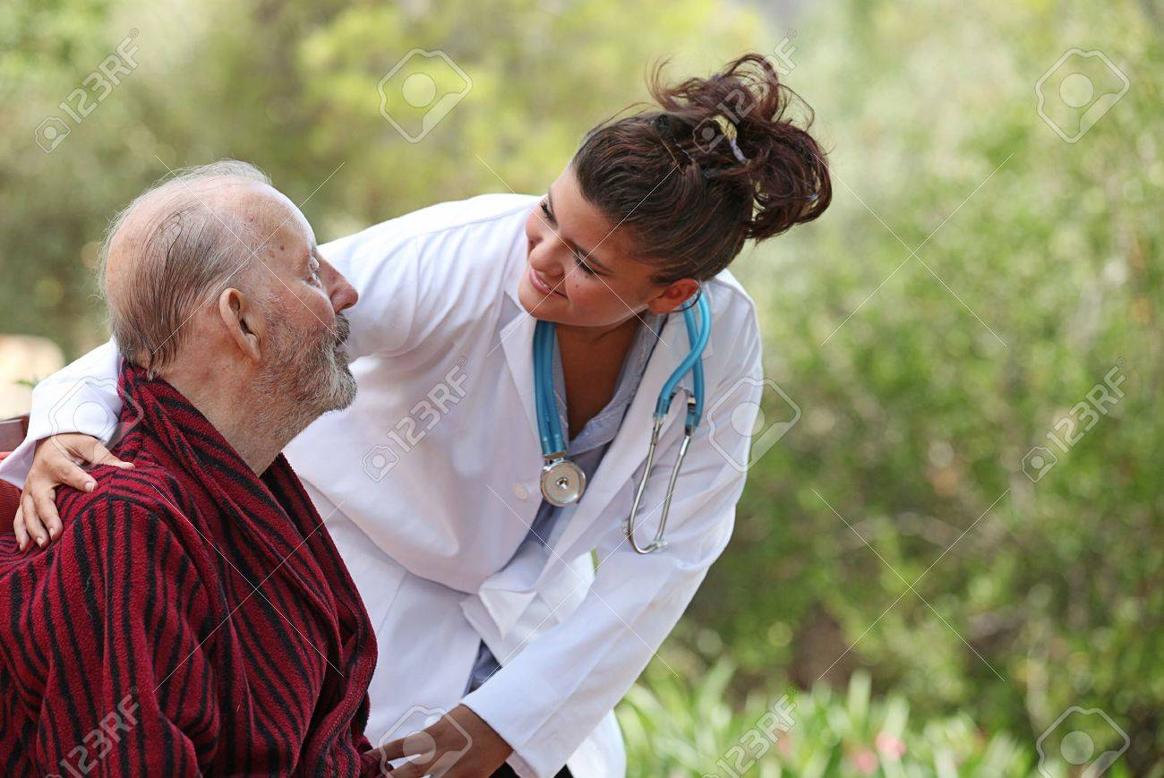 Nurse showing care to patient Stock Photo - 10135174