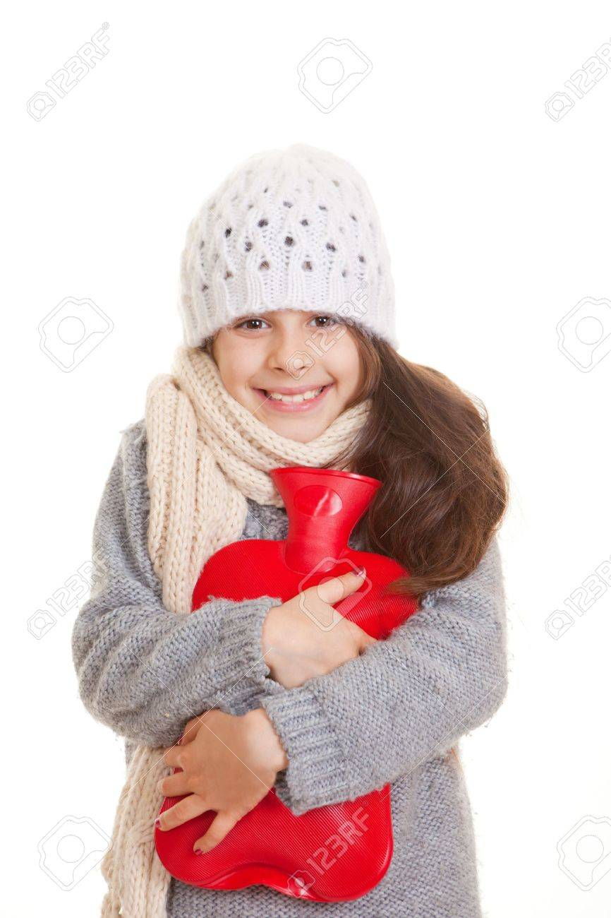 winter child hugging hot water bottle for warmth Stock Photo - 17850763