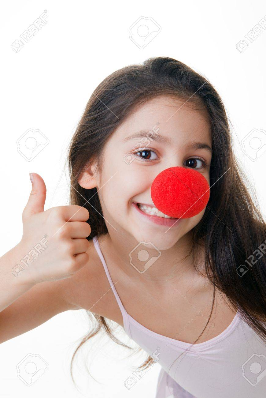 child with red clown nose thumbs up Stock Photo - 17888737
