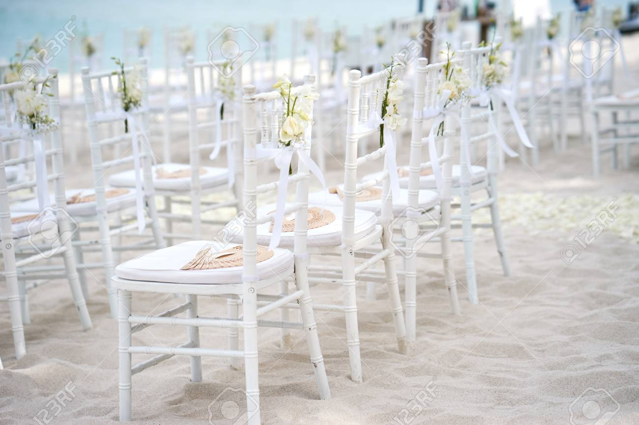 A Group Of White Chiavari Chairs On The Beach Wedding Preparation Stock Photo Picture And Royalty Free Image Image 96906881