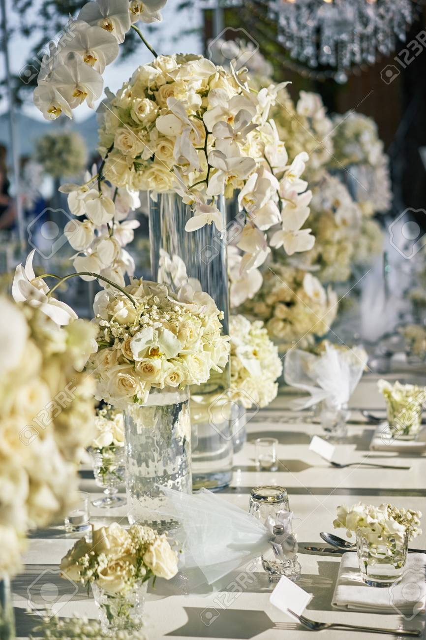 A bunch of white and cream roses orchids the babys breath stock a bunch of white and cream roses orchids the babys breath gypsophila mightylinksfo