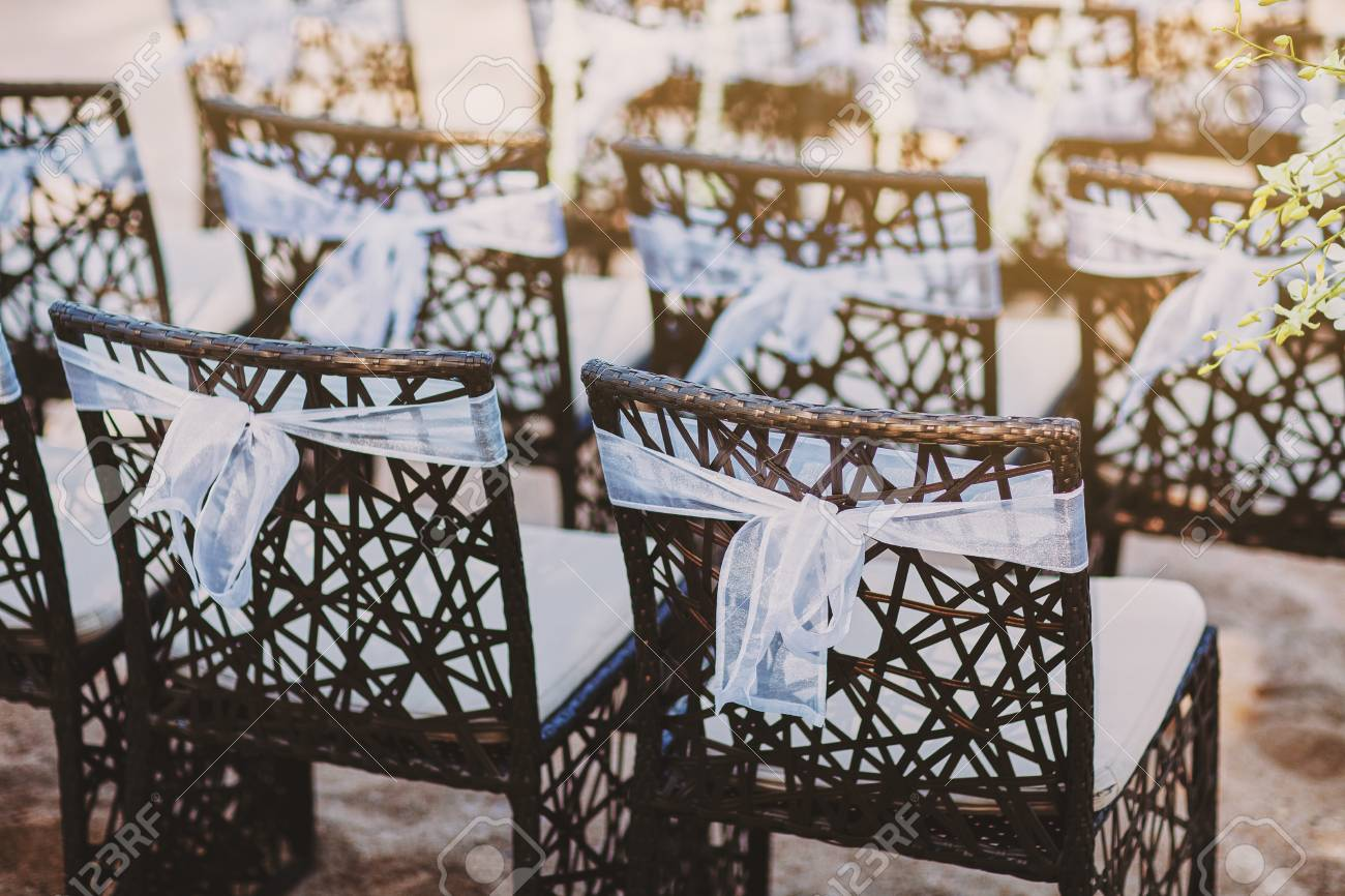 A Group Of Black Wooden Chairs Decorated With White Organza Sash Stock Photo Picture And Royalty Free Image Image 101524069