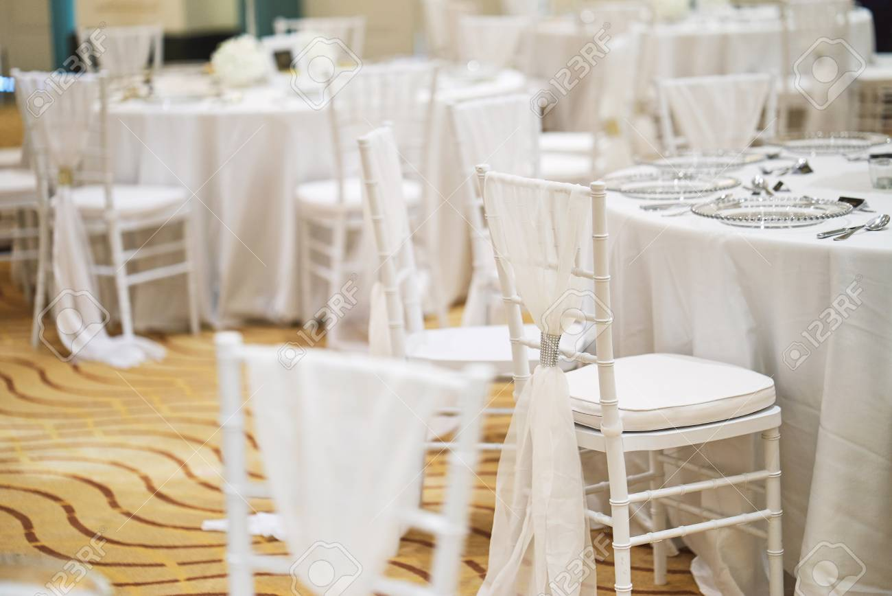 Stock Photo   Wedding Reception Dinner Table Setting Indoor With White  Chiavari Chairs For Luxury Wedding Party