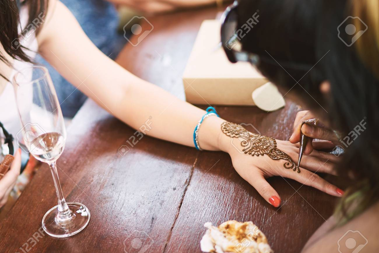 Indian Henna Tattoo Artist Painting The Artwork On Women Foot ...