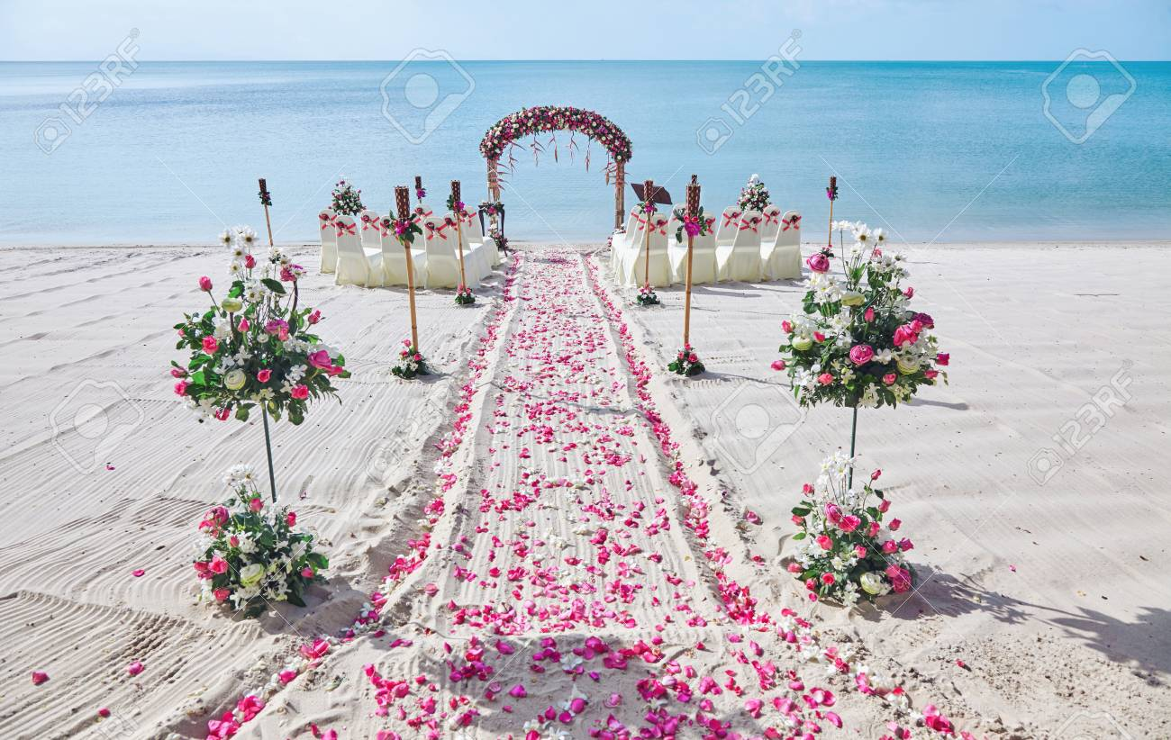 106198514 beach wedding venue setting on the white sand with beautiful panoramic ocean view background pink an - pink beach wedding dress