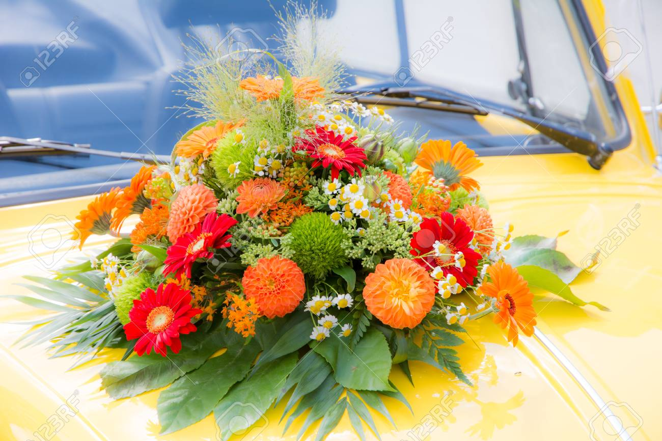 Bridal Bouquet On A Yellow Wedding Old Timer Car Stock Photo