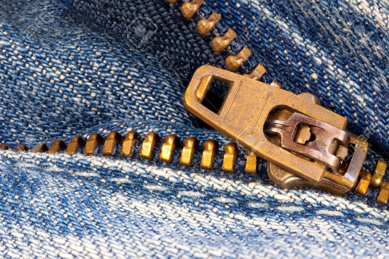 Open zipper of a worn out blue jeans - 141035231