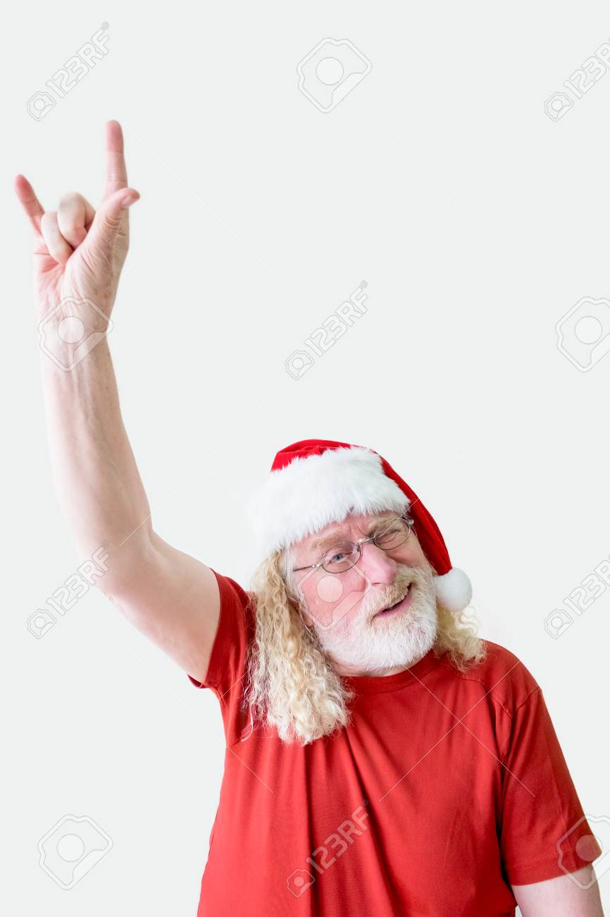 62edffaa72175 Grinning Man in Santa Hat with Devil Horns Gesture Stock Photo - 91444942