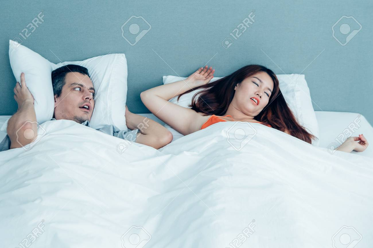 Snoring Woman And Husband Covering Ears Stock Photo Picture And Royalty Free Image Image 96355243