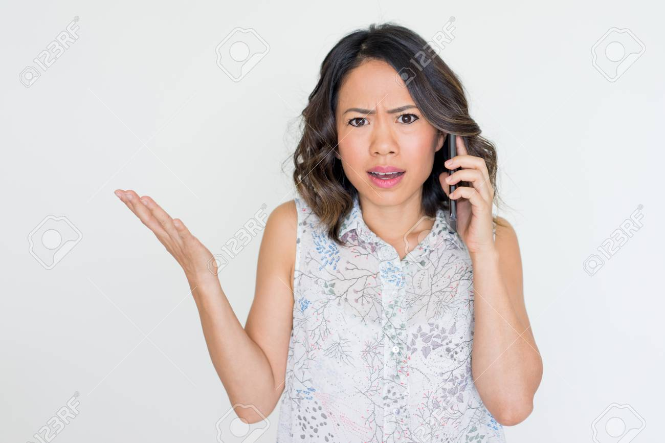 Angry Young Asian Lady Talking On Phone Stock Photo, Picture And Royalty Free Image. Image 96963998.