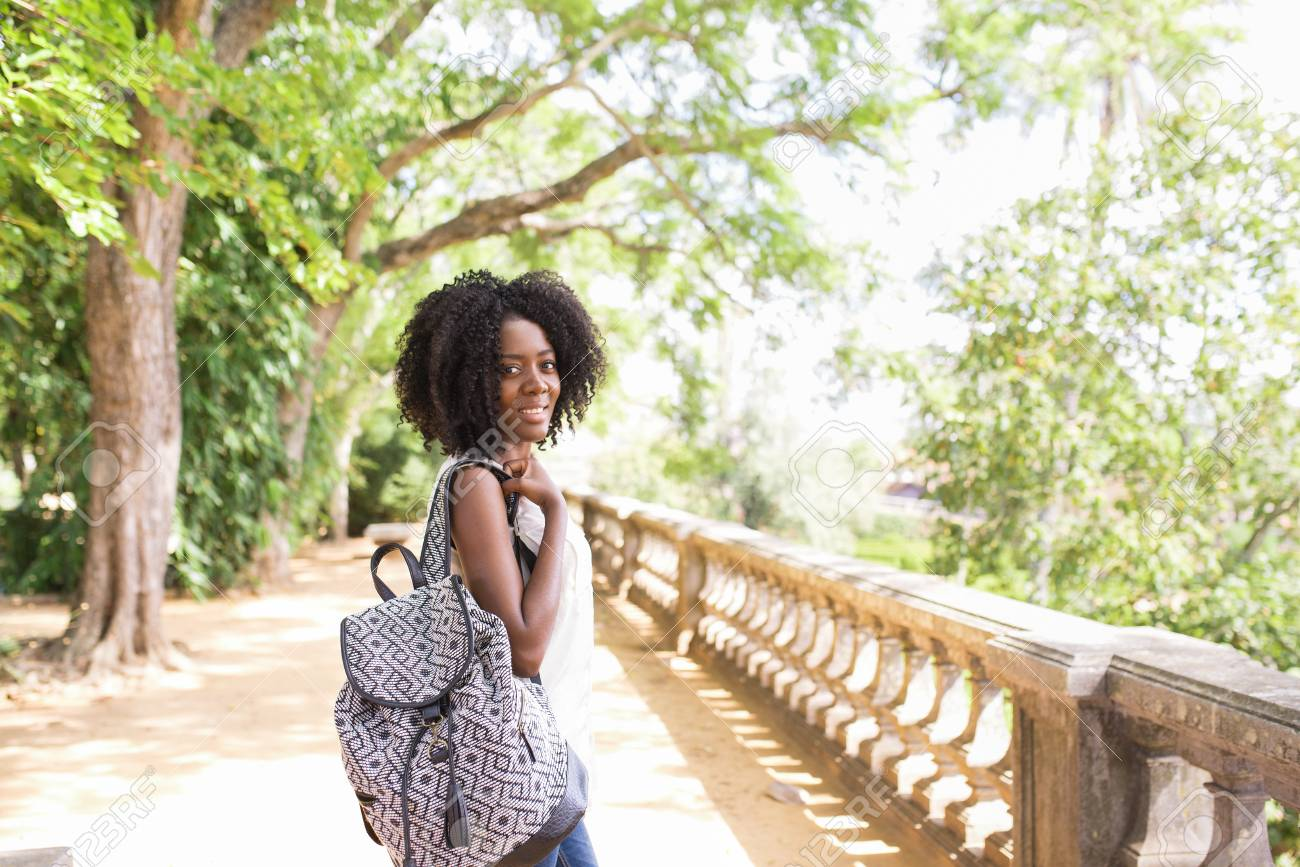 Side View Of Smiling Black Woman With Backpack In City Park Stock Photo Picture And Royalty Free Image Image 98118173