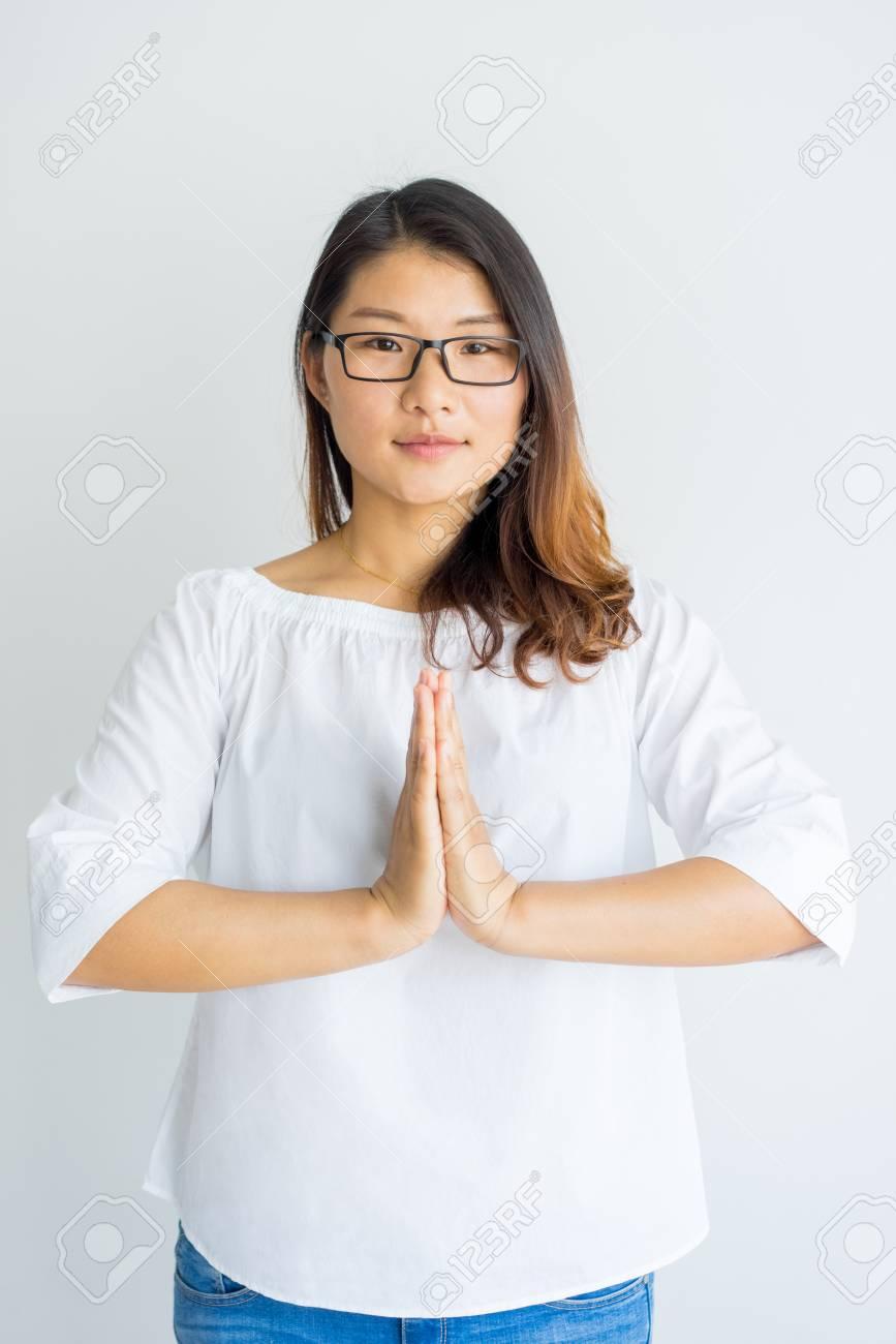 Calm Yoga Teacher Making Namaste Gesture For Greeting Serious