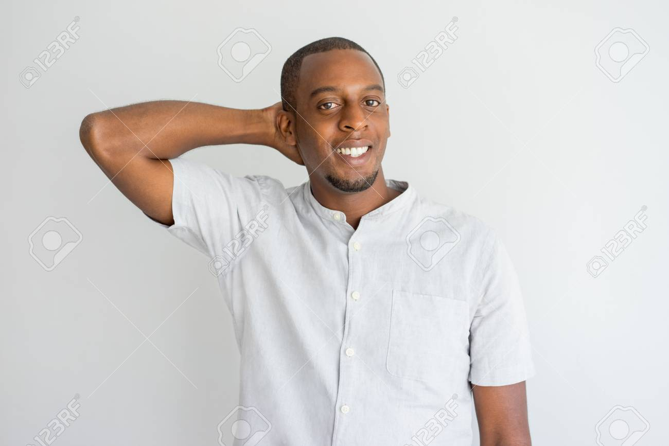 Shy Handsome African American Guy Scratching Back Of Head And