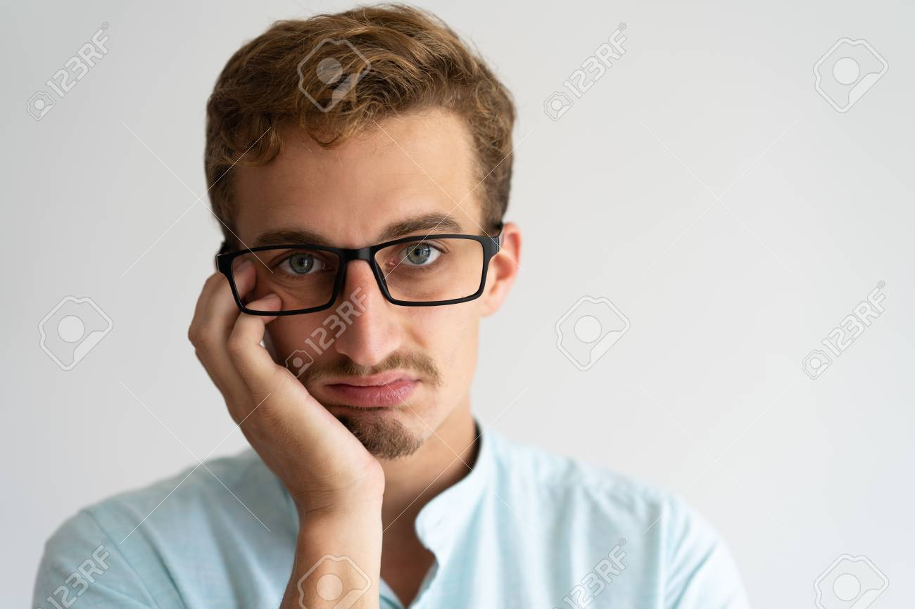 closeup of upset annoyed blonde guy with disgusted face bored