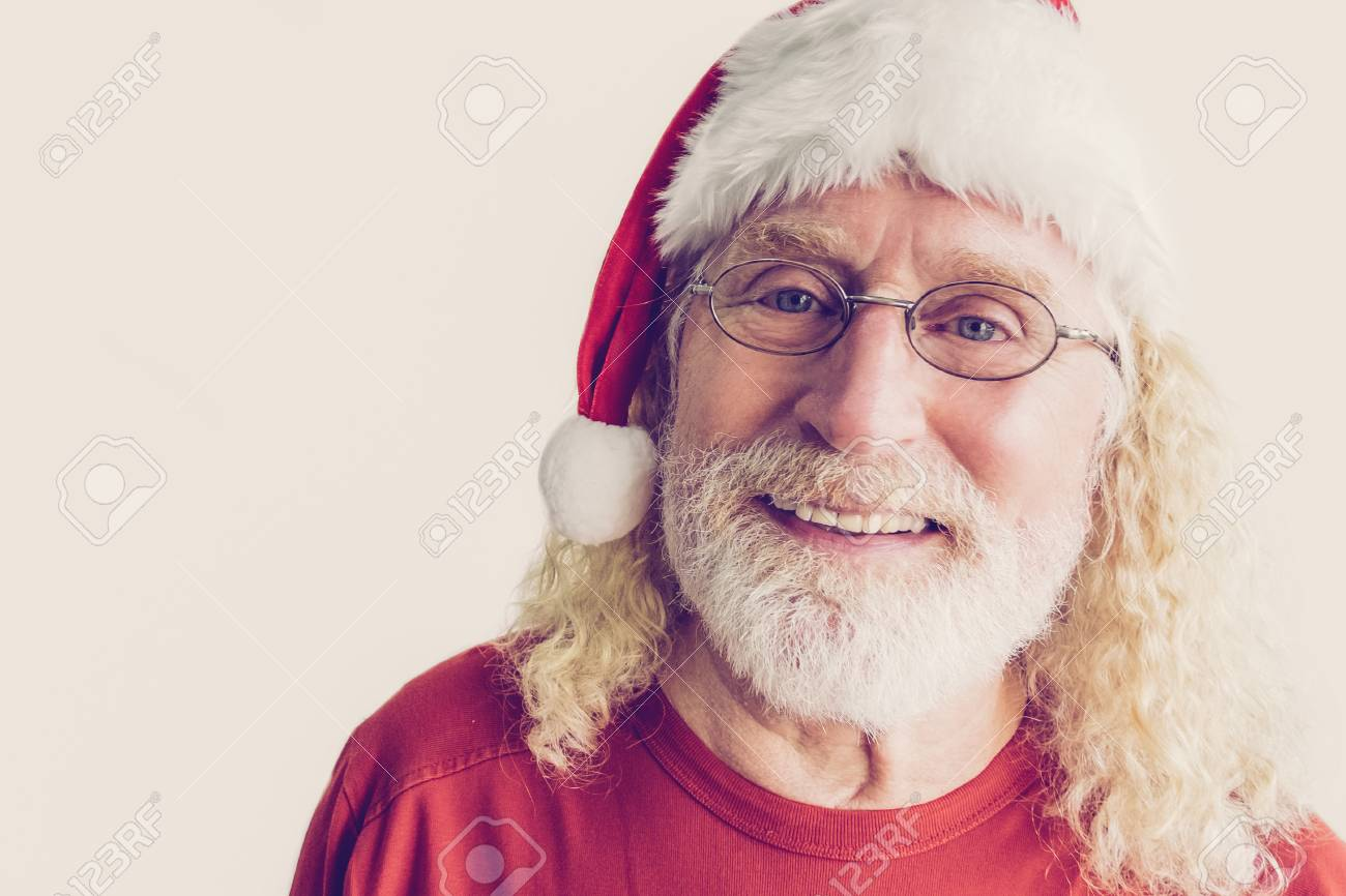73ad2b49b40 Portrait of happy Santa Claus. Studio shot of cheerful old man in Christmas  hat.
