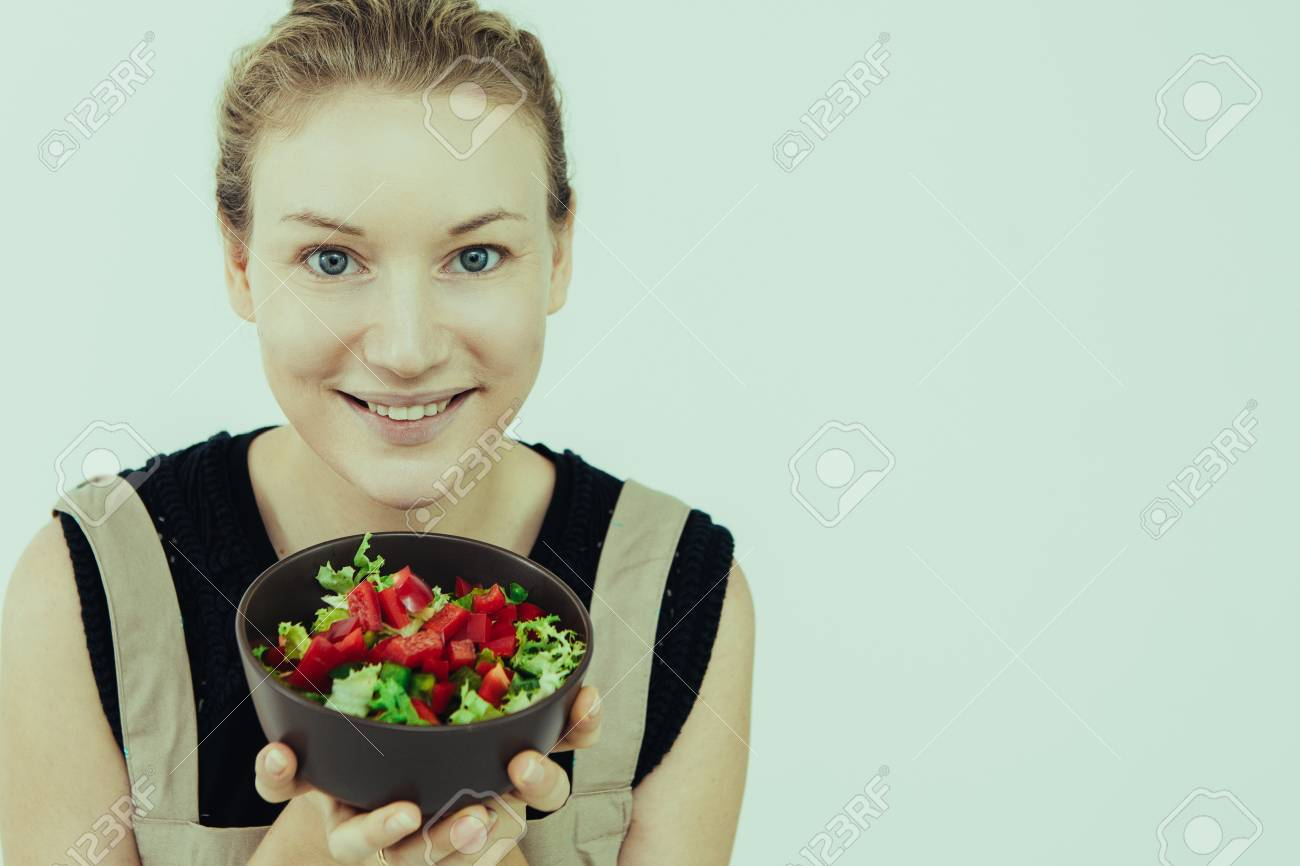 Closeup Of Smiling Caucasian Woman Holding Bowl With Raw Vegetable