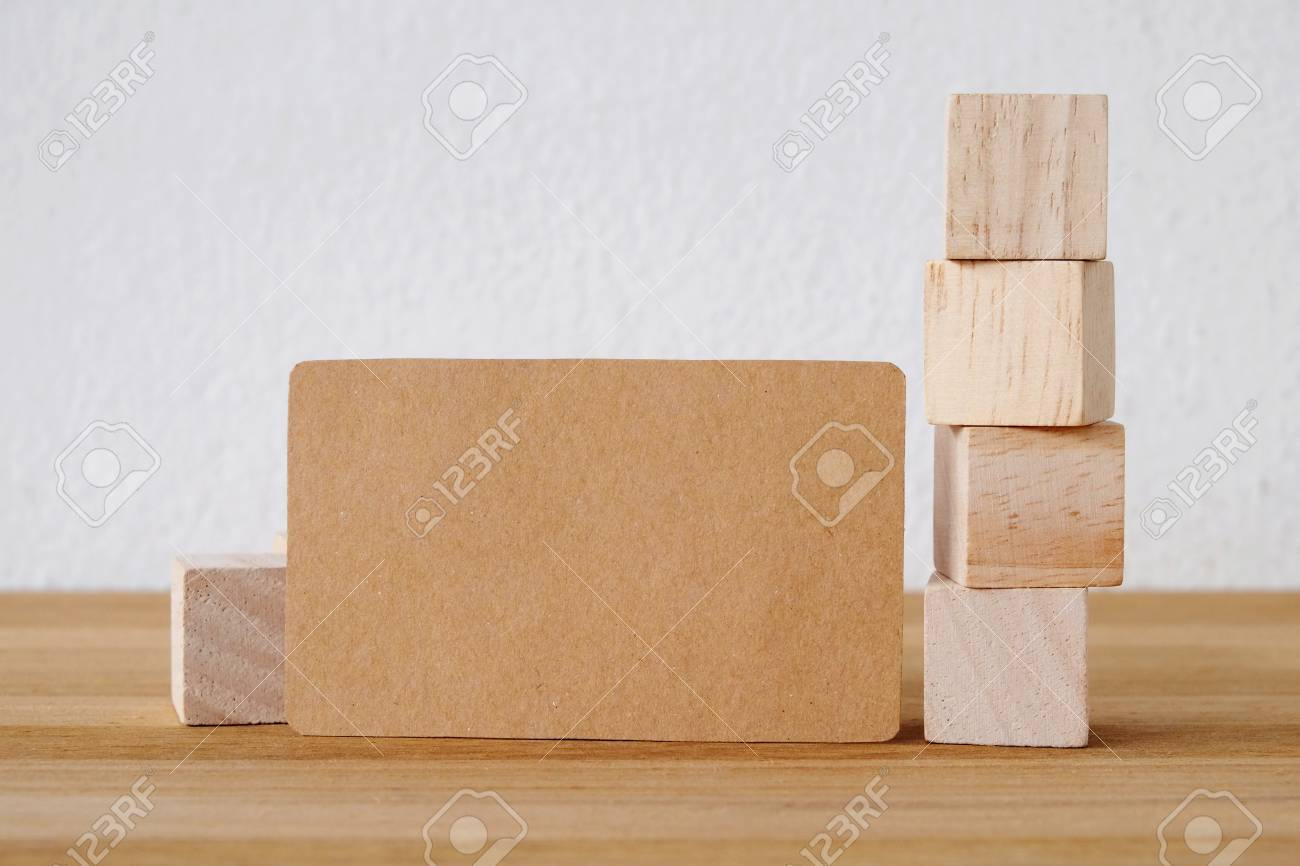 Blank Recycle Paper Business Card And Wooden Cubes On Table And ...