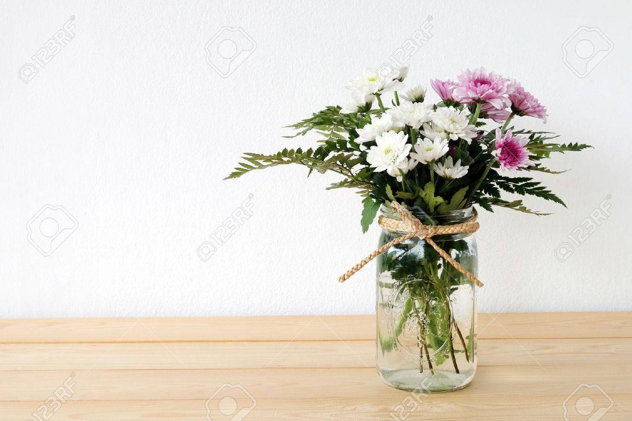 White and pink daisy bouquet in mason jar on table background stock photo white and pink daisy bouquet in mason jar on table background fresh flower izmirmasajfo