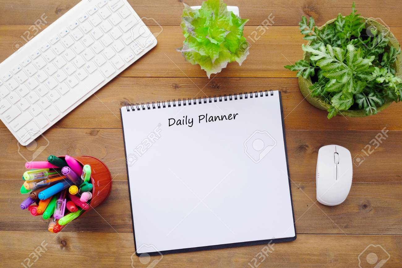 graphic relating to Daily Planner Notebook named Day-to-day planner upon blank laptop paper upon business office table historical past,..