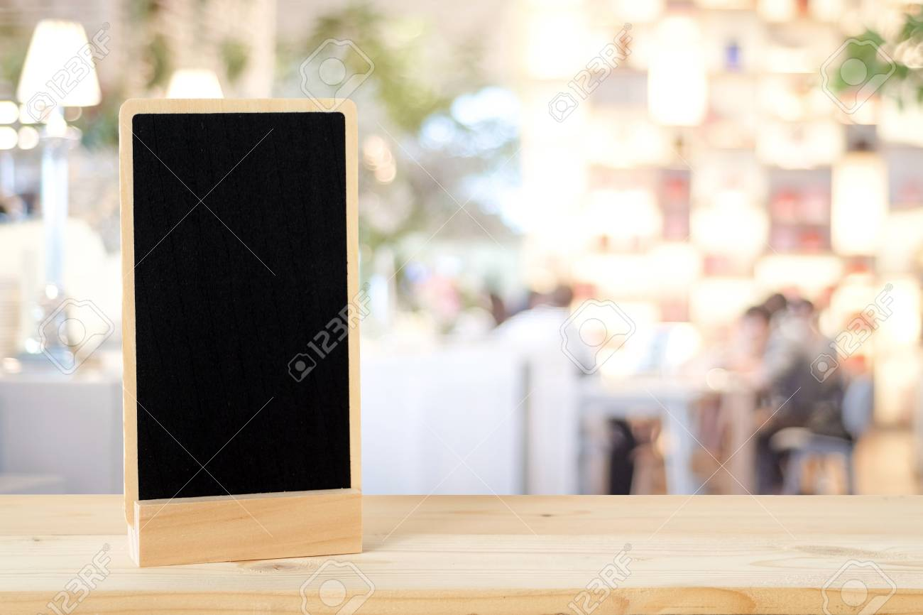 Blank Chalkboard Standing On Wood Table Over Blur Restaurant Stock - Standing table for restaurant
