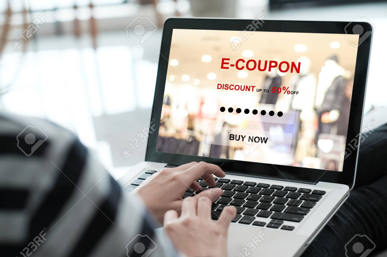 Woman typing discount coupon code on laptop screen to get the