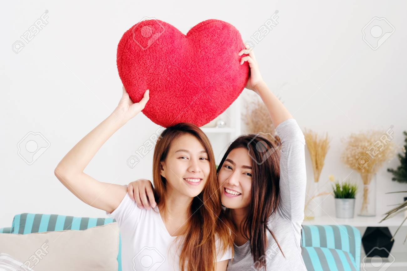 Stock Photo Young Cute Asia Lesbians Holding Red Heart Shape Willow Together Smiling With Happiness At Home Lgbt Couple Lesbians Valentines Day