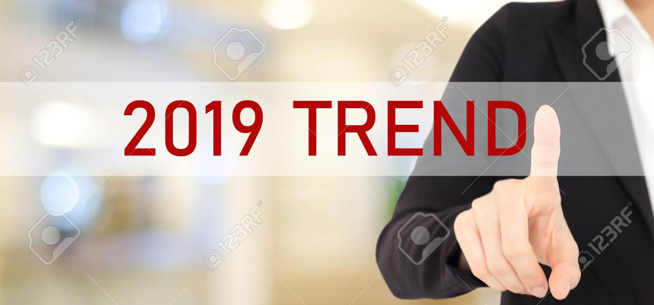 Businesswoman hand touching 2019 trend over blur office background, banner, 2019 business strategy annual plan, success in business concept - 107907349