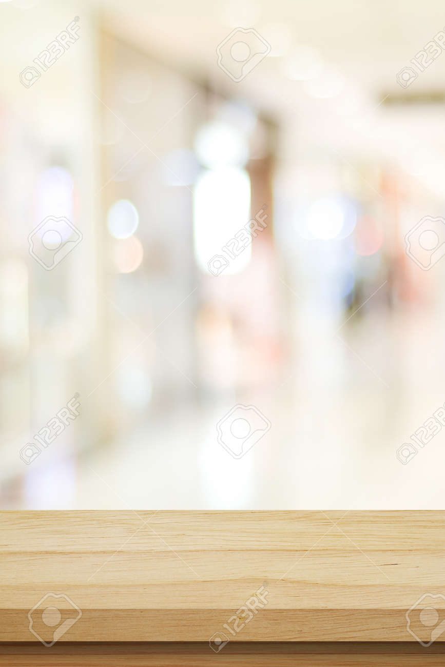 Vertical wood table background and blur background, Empty wooden counter, shelf surface over blur restaurant with bokeh background, Wood table top for retail shop, store product display backdrop, banner, mock up, template - 167002009