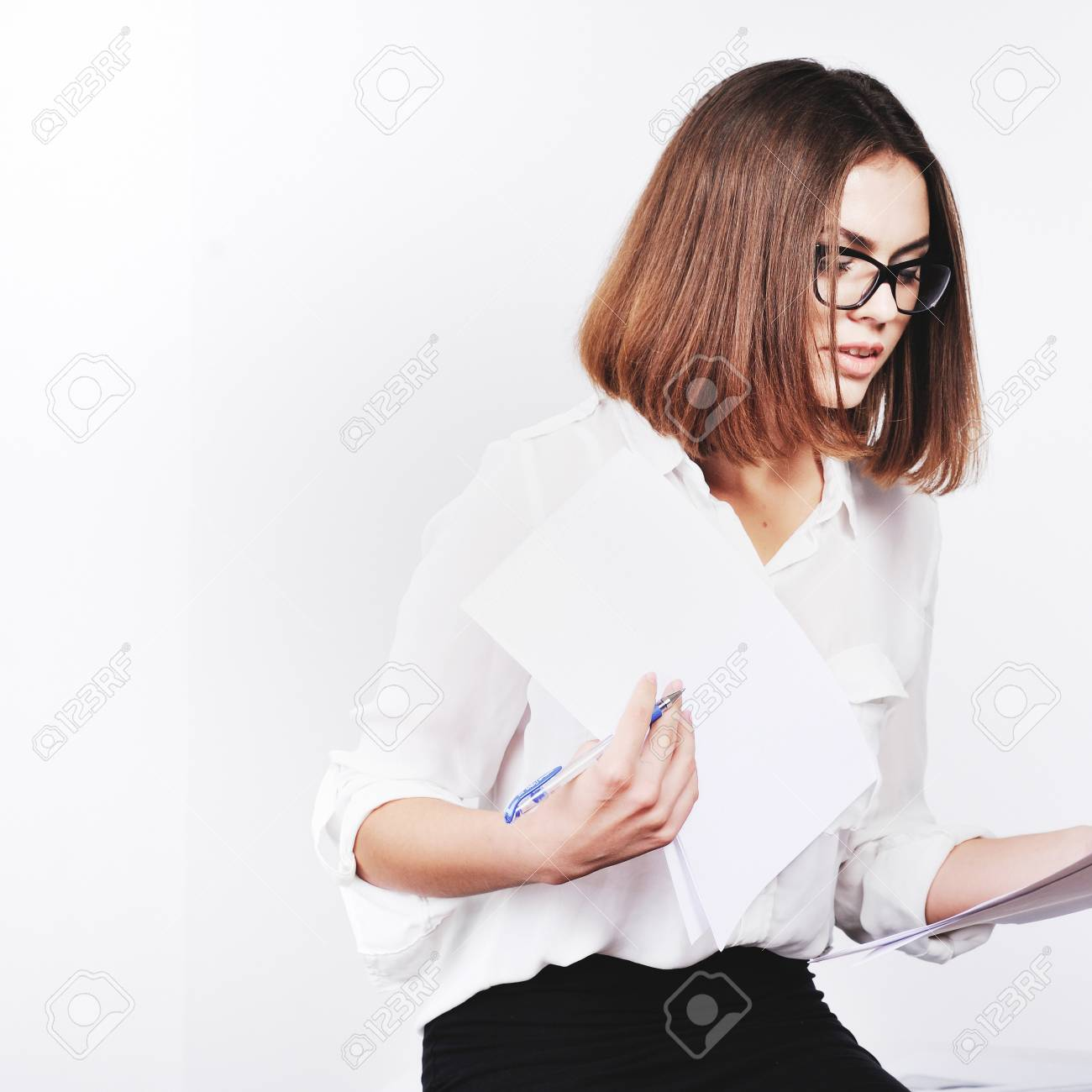 Portrait Of Beautiful Young Secretary Woman Working With Papers