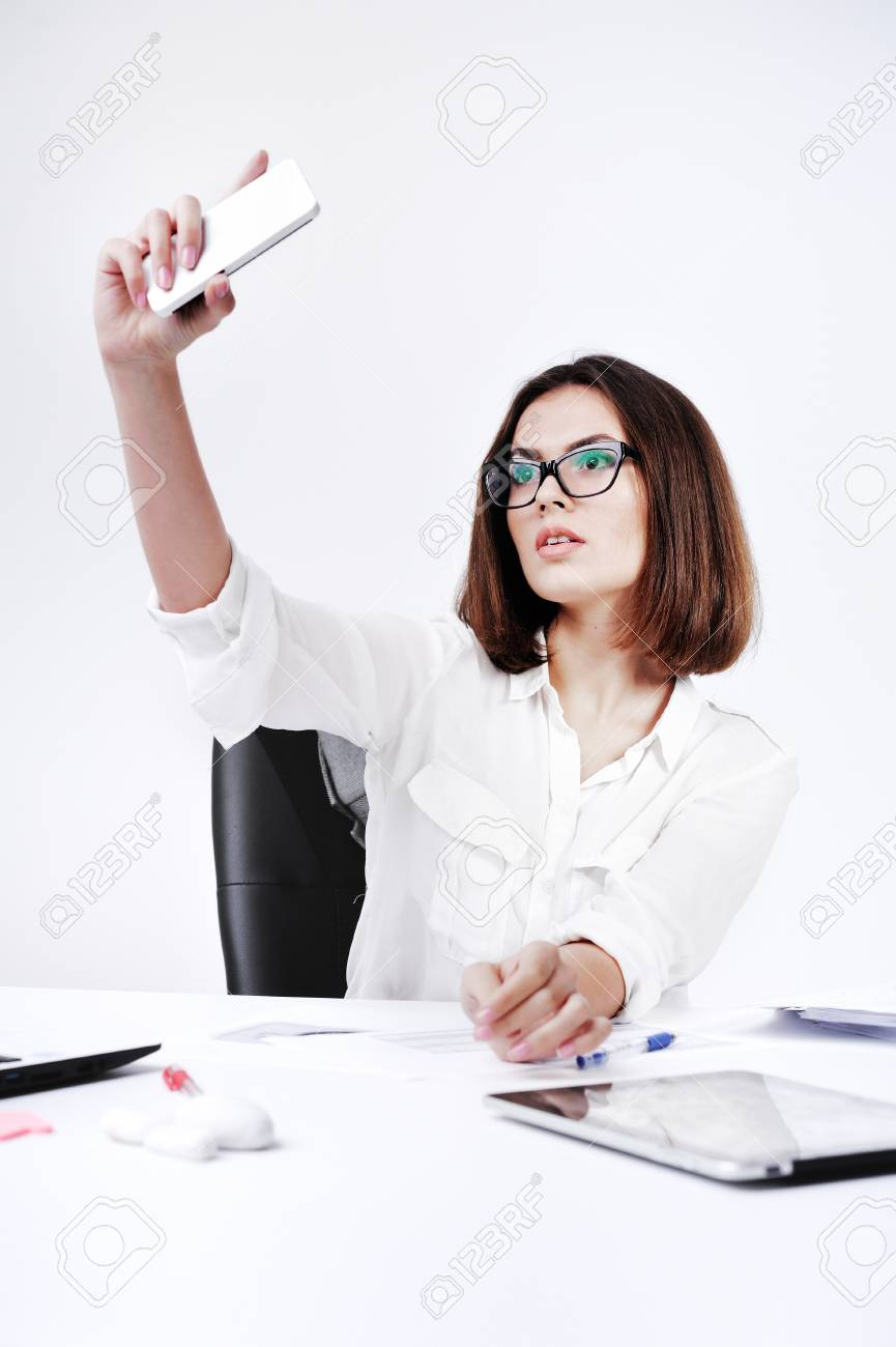 Young Secretary Woman Doing Selfie At Working Place Stock Photo