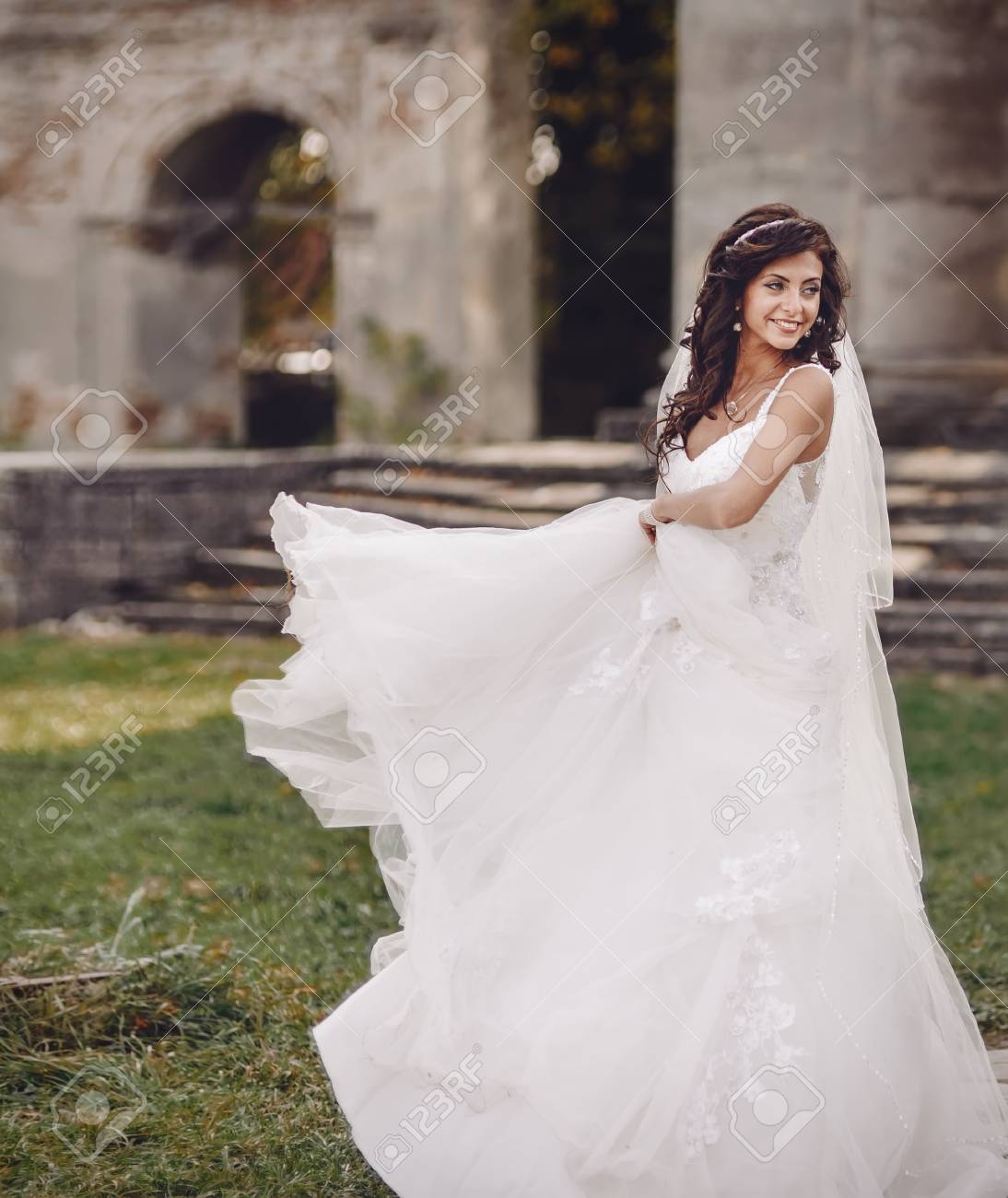 Young Bride Playing With Wedding Dress Next To Ancient Castle Stock ...