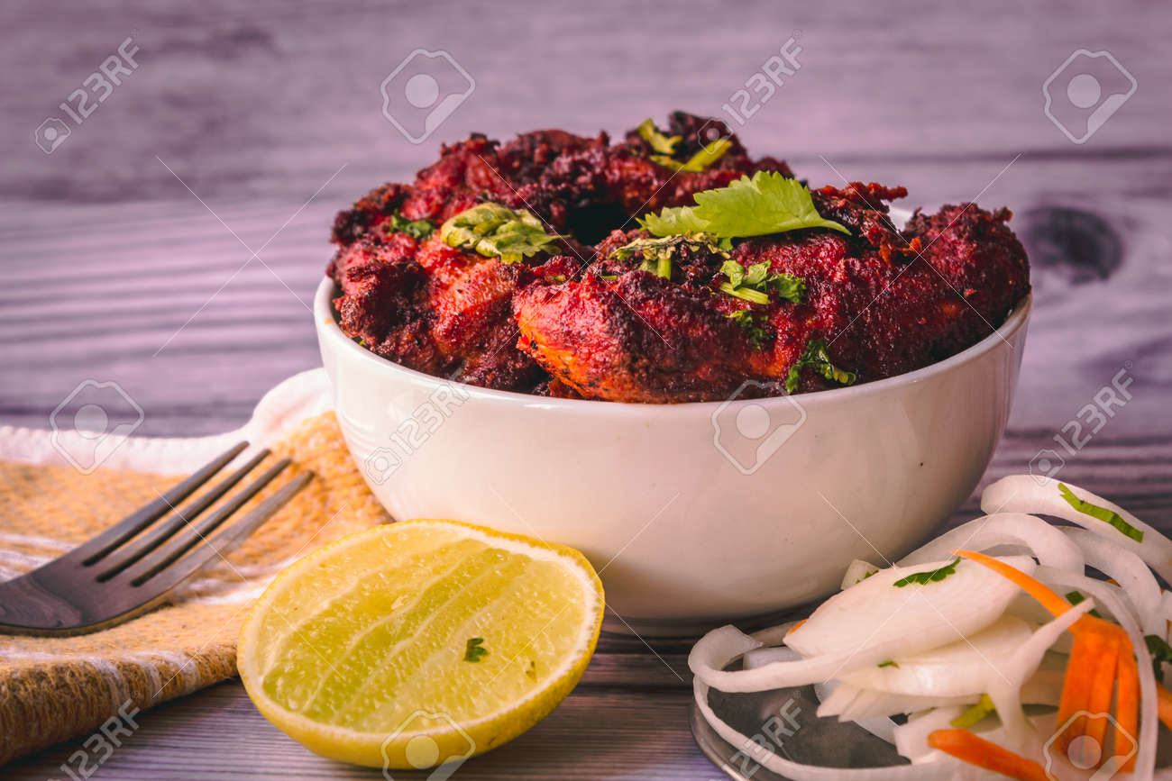 Deep fired chicken known as chicken 65 in south india. Spicy fried chicken with relish - 165339407