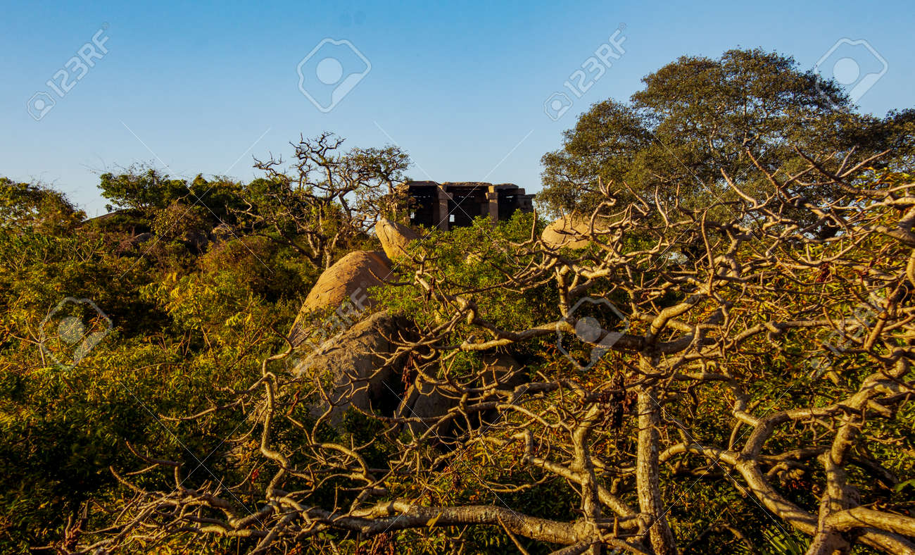 View of an old shed made out of rocks in the old port city, Mahabalipuram, Tamil Nadu, India. Focus set on the rocks and shed - 165825610