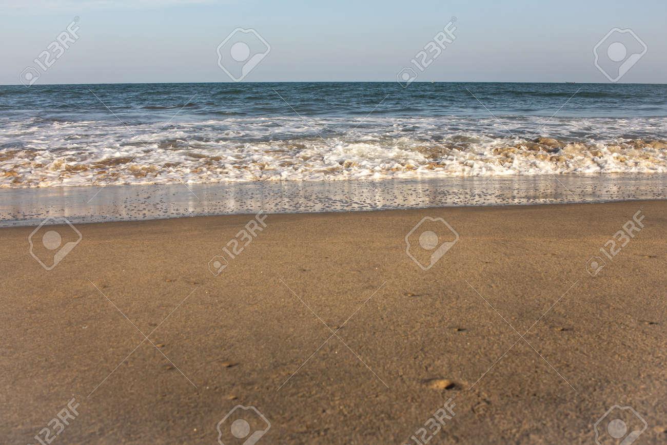 Beautiful view of waves along the beach in coastal town of Mahabalipuram, India - 166460313