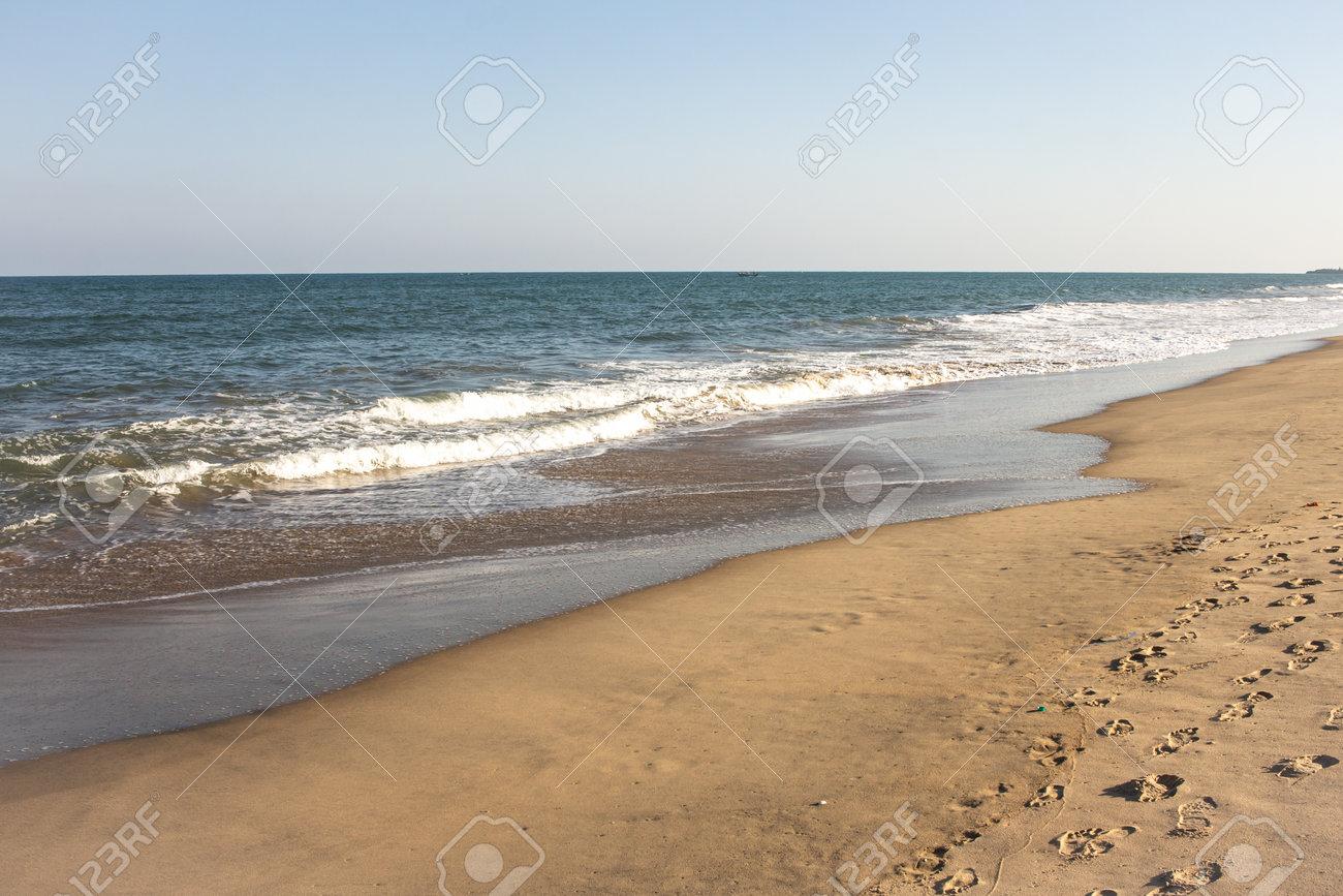 Beautiful view of waves along the beach in coastal town of Mahabalipuram, India - 166460360