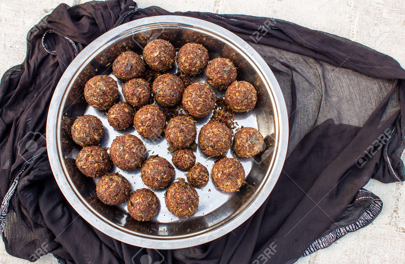 Round balls of Vadouvan (occasionally spelled vaudouvan) is a ready-to-use blend of spices used in cooking. Sun dried blend of spices - 169342325