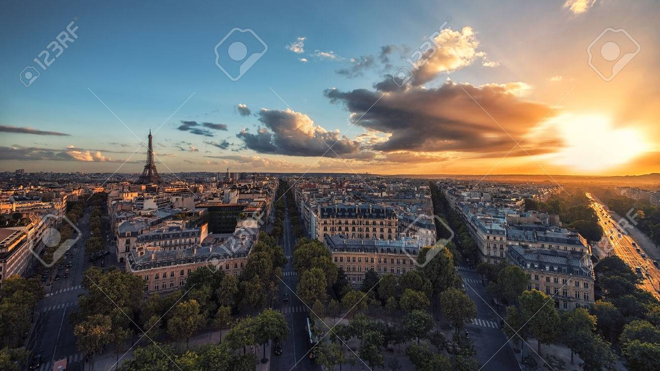 Sunset over Paris and the Eiffel tower - 69242260