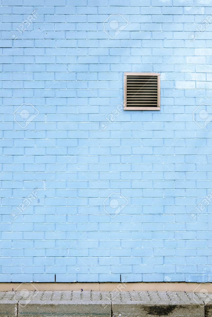 Ventilation Grille On The Blue Brick Wall, Tiled Floor, Sun Flares ...